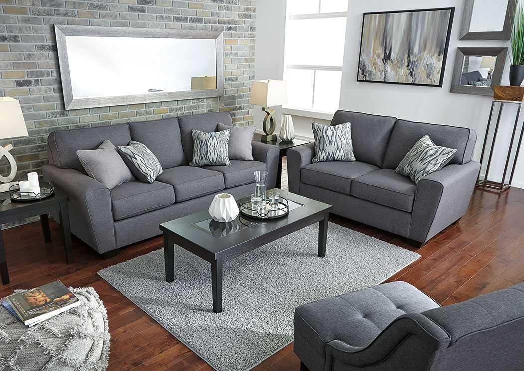 светло серые обои и коричневый диван фото белого или